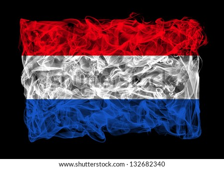 The flag of Netherlands consists of a smoke - stock photo