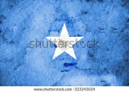 The Flag of Somalia, also known as the Somali Flag, is the official flag of the Federal Republic of Somalia. Adopted on October 12, 1954, it was designed by Mohammed Awale Liban. - stock photo