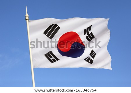 The flag of South Korea, or Taegeukgi has three parts - a white background, a red and blue taegeuk (also known as Taiji and Yinyang) in the center, and 4 black trigrams, one in each corner of the flag - stock photo