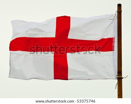 The flag of St George fluttering proudly in the wind - stock photo