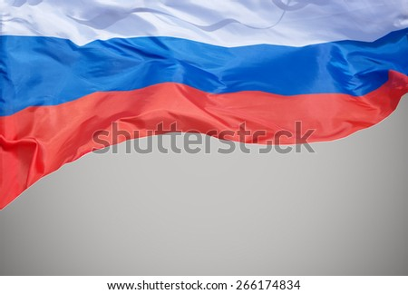 The flag of the Russian Federation waving in the wind. - stock photo