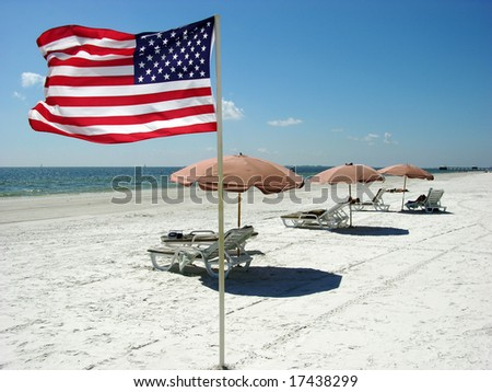 The flag of United States on Fort Myers town beach in Florida.