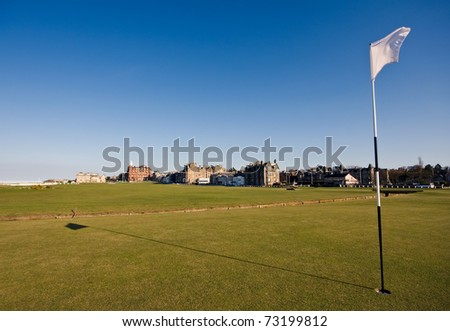 The flag on the first hole of the famous Old Course links in St Andrews on a clear sunny afternoon.