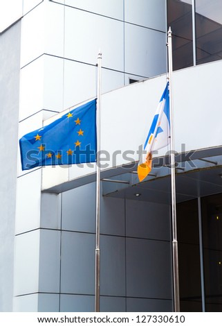 The Flags of the European Union, and other on office business building background - stock photo