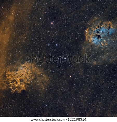 The Flaming Star and Tadpole Nebulae in the Hubble Palette - stock photo