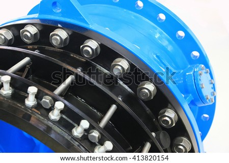The flanges of valves with bolts and nuts. Connecting fittings of different diameters. - stock photo