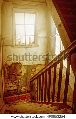 The flight of stairs in an old house.