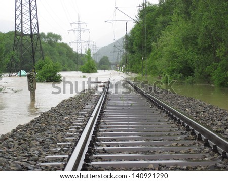 The Flooded Straight Railway Track with Timber Sleepers. - stock photo