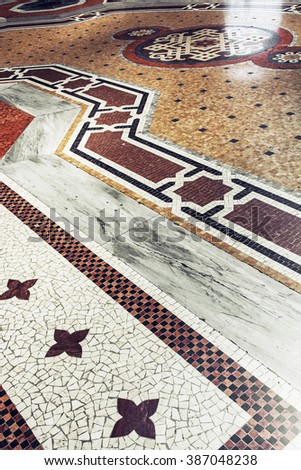 The floor in Galleria Vittorio Emanuele II in Milan, Italy, Europe. Stone artistic pavement. - stock photo