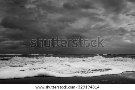 the Florida shoreline on the Atlantic Ocean side right before a major downpour in Black and White - stock photo