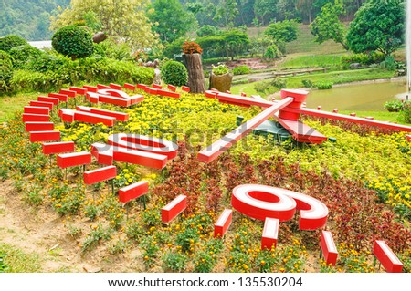 The flower clock in botanical park, Thailand - stock photo