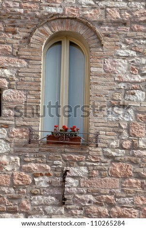 The Flowers on the old Tuscan Window - stock photo