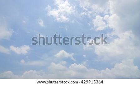 The fluffy cloud on sky - stock photo