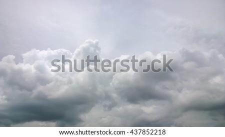 The fluffy gray cloud on sky - stock photo