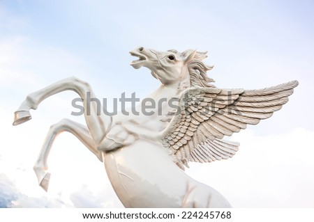 The flying horse statue on the sky with clouds. - stock photo