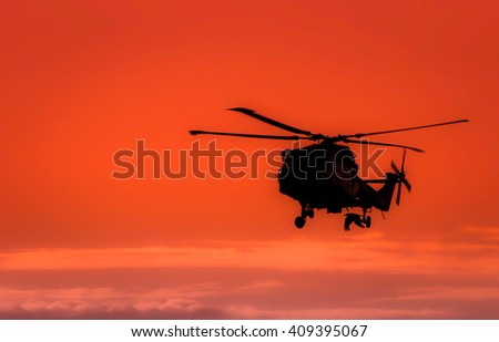 The follower,helicopter in the sunset sky ,silhouette helicopter and bird