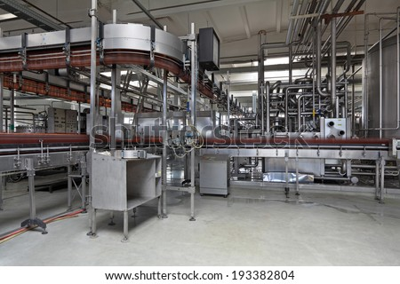 The food industry. Plastic beer bottles moving on conveyor - stock photo