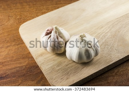 The food ingredient, garlic on the wooden plate