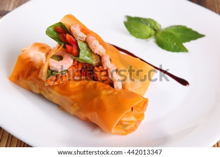 the food paper rolls with prawns in Oriental style on plate