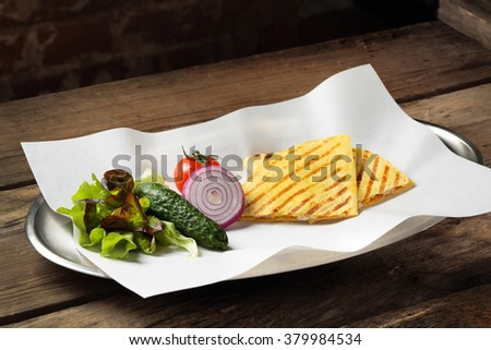 The food with vegetables on a platter - stock photo