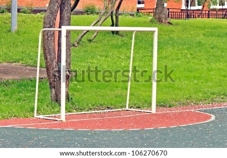 The football goals on the children playing field - stock photo