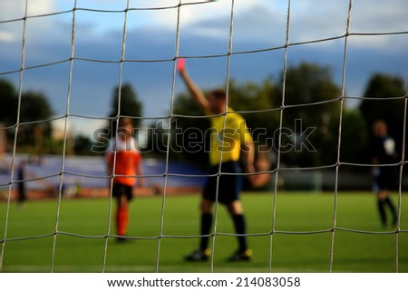 The football net and referee with red card on background - stock photo