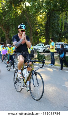 The foreigner ride the bicycle with wai gesture participating in Bike for Dad event on December 11, 2015 in Chiang Mai, Thailand. The event is held for celebrating for the king birthday.