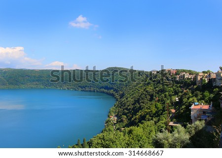 The forested shores around the small, volcanic Lake Nemi from Castel Gondolfo, Italy