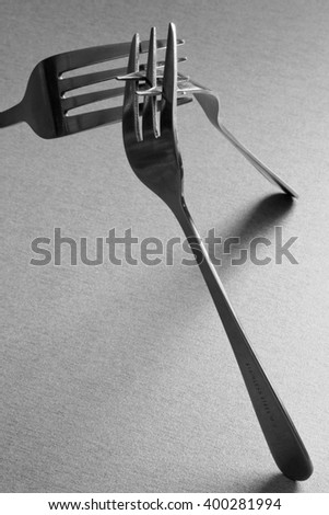 The forks of stainless steel.Set from several different forks