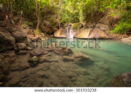 The forth level of Erawan waterfall in Thailand, clear water - stock photo