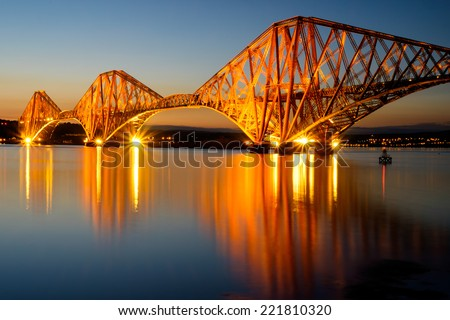 The Forth Rail bridge illuminated at dawn, Edinburgh, Scotland - stock photo
