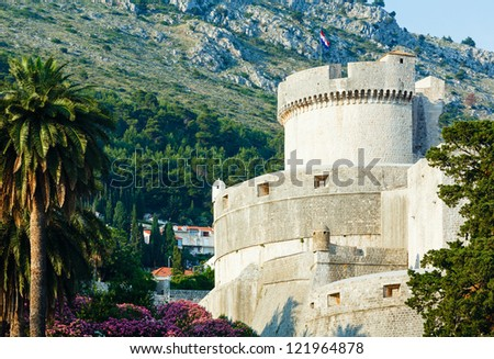 The fortress of Dubrovnik Old Town and the Minceta Tower with Croatian national flag. - stock photo