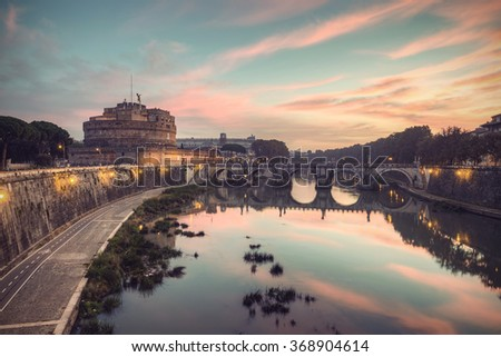 The fortress of Sant'Angelo (Castel Sant'Angelo) and bridge over river Tiber (Fiume Tevere) at a spectacular sunrise, Rome, Italy, Europe, vintage filtered style - stock photo