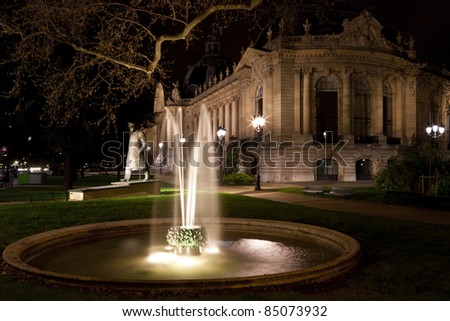 The fountain and statue of Winston Churchill near the Petit Palais in Paris at night. France. - stock photo