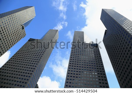 The four beautiful high building in Singapore. Blue Sky, Cloud, as business background or print card