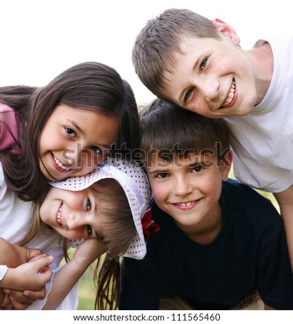 The four children are in the fresh air - stock photo