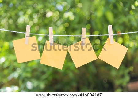 the four of sticky note hanging on the clothesline with the garden background