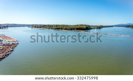 The Fraser River as it flows west around Barnston Island near the town of Langley British Columbia, Canada. The photo was taken from the Golden Ears Bridge - stock photo
