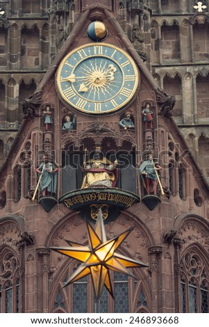 The Frauenkirche - Church of Our Lady with the clock - The M���¤nnleinlaufen. Nuremberg, Bavaria, Germany - stock photo