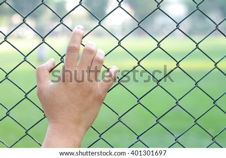 The freedom is priceless!!  A man's hand on the mesh fence show how much he wants to get through the other side.