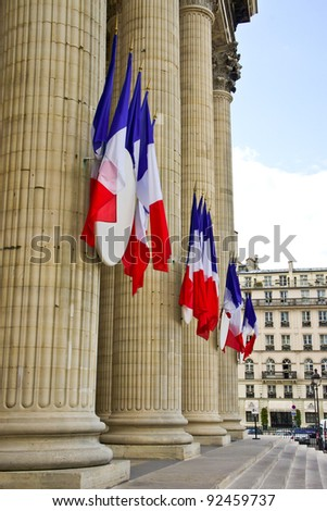 The French tricolor flags hang on the Pantheon during the Fete Nationale (Bastille Day)