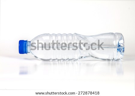 the fresh drink water bottle horizontal placed on white background - stock photo