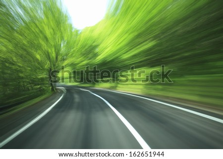 The fresh green way through which it flows - stock photo