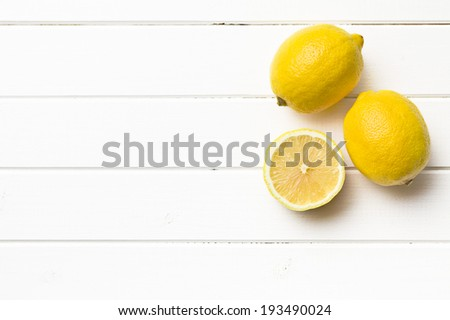 the fresh lemon on kitchen table - stock photo