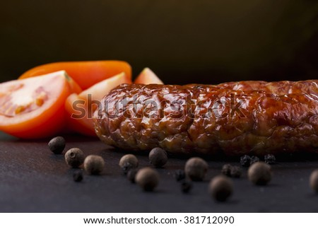 the fried sausage on a black background