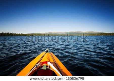 The front end of a Kayak traveling on the system of lakes in northern Russia - stock photo