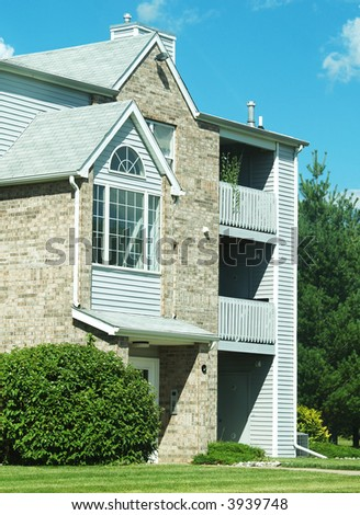 the front exterior of an apartment building - stock photo
