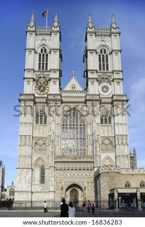 The front facade and towers of Westminster Abbey, London, UK, just as the sun is getting low in the sky. - stock photo