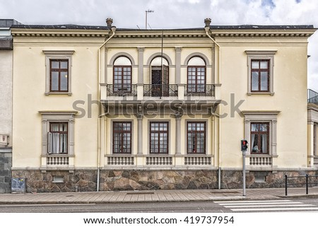 The front facade of one of the many beautiful old historic buildings that Helsingborg in Sweden has to offer. - stock photo