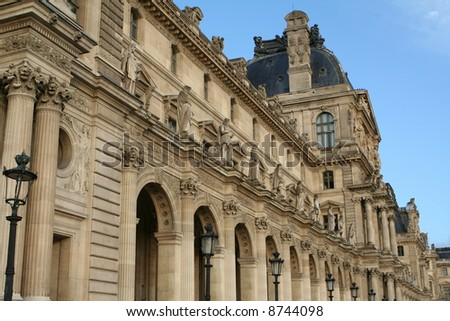 The front facade of the Louvre - stock photo